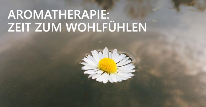 Aromatherapie - Kamillenblüte schwimmt auf dem Wasser